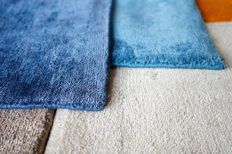 Bambusilkes mattor handknutna och handvävda